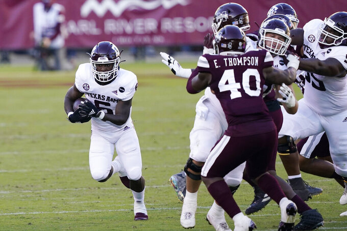 Texas A&M wide receiver Jalen Preston (5) takes a pass past Mississippi State linebacker Erroll Thompson (40) during the second half of an NCAA college football game in Starkville, Miss., Saturday, Oct. 17, 2020. (AP Photo/Rogelio V. Solis)
