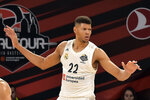 """FILE - In this Friday, May 17, 2019 file photo, Madrid's Walter Tavares gestures during the Euroleague Final Four semifinal basketball match between CSKA Moscow and Real Madrid at the Fernando Buesa Arena in Vitoria, Spain. While the AfroBasket tournament doesn't boast the star power of an Olympics, it does showcase ever-competitive and improving quality of basketball on the continent. Tiny Cape Verde has one big advantage as it tries to become champion of African basketball for the first time: 7-foot-3 former NBA draft pick Walter """"Edy"""" Tavares.  (AP Photo/Alvaro Barrientos, file)"""