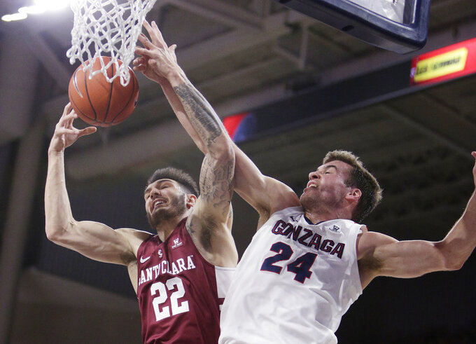 Santa Clara forward Josh Martin (22) and Gonzaga forward Corey Kispert (24) go after a rebound during the first half of an NCAA college basketball game in Spokane, Wash., Saturday, Jan. 5, 2019. (AP Photo/Young Kwak)