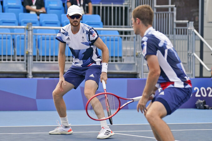 British doubles team Neal Skupski, right, and Jamie Murray watch as a ball goes between them during the second round of the tennis competition at the 2020 Summer Olympics, Monday, July 26, 2021, in Tokyo, Japan. (AP Photo/Seth Wenig)