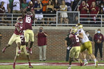 Florida State defensive back Travis Jay (18) intercepts a pass at the end of the fourth quarter of an NCAA college football game against Notre Dame Sunday, Sept. 5, 2021, in Tallahassee, Fla. Notre Dame won 41-38 in overtime. (AP Photo/Phil Sears)