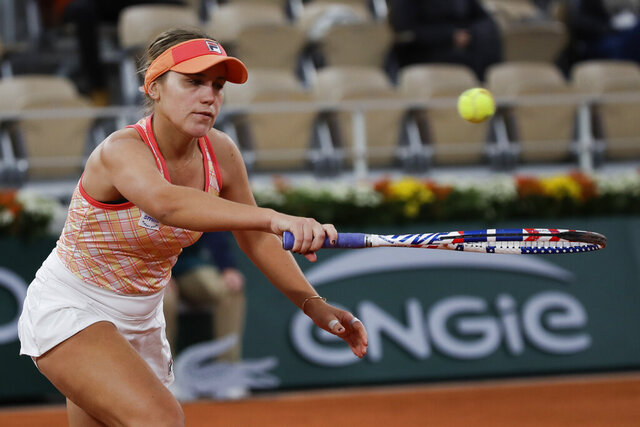 Sofia Kenin of the U.S. plays a shot against Romania's Ana Bogdan in the second round match of the French Open tennis tournament at the Roland Garros stadium in Paris, France, Thursday, Oct. 1, 2020. (AP Photo/Alessandra Tarantino)