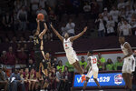 Florida State guard Devin Vassell (24) shoots over Virginia Tech defender Nahiem Alleyne (4) during the second half of an NCAA college basketball game in Blacksburg, Va., Saturday, Feb. 1, 2020. (AP Photo/Lee Luther Jr.)