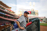 Milwaukee Brewers manager Craig Counsell stands in the dugout during the first inning of the team's baseball game against the Cincinnati Reds, Tuesday, Sept. 24, 2019, in Cincinnati. (AP Photo/John Minchillo)