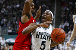 Michigan State guard Cassius Winston (5) drives on Maryland forward Donta Scott (24) in the second half of an NCAA college basketball game in East Lansing, Mich., Saturday, Feb. 15, 2020. (AP Photo/Paul Sancya)