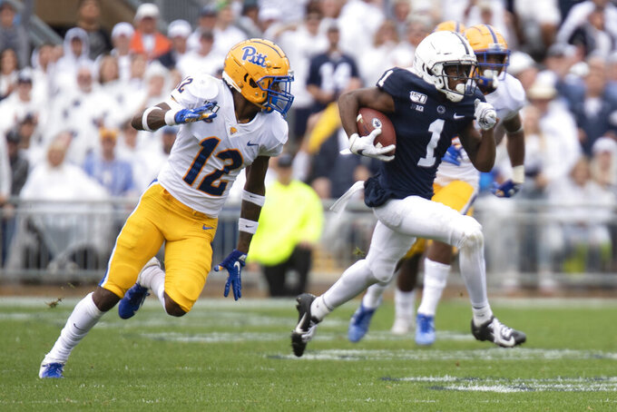 Penn State wide receiver KJ Hamler (1) breaks away from Pittsburgh defensive back Paris Ford (12) in the first half of an NCAA college football game in State College, Pa., on Saturday, Sept. 14, 2019. (AP Photo/Barry Reeger)