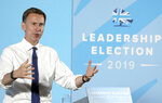 Britain's Conservative Party leadership candidate Jeremy Hunt speaks during a party leadership hustings meeting in Maidstone, southern England, Thursday July 11, 2019.  The two contenders, Jeremy Hunt and Boris Johnson are competing for votes from party members, with the winner replacing Prime Minister Theresa May as party leader and Prime Minister of Britain's ruling Conservative Party. (Gareth Fuller/PA via AP)