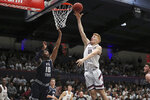 Saint Mary's forward Matthias Tass (11) shoots over Utah State forward Alphonso Anderson (10) during the first half of an NCAA college basketball game in Moraga, Calif., Friday, Nov. 29, 2019. (AP Photo/Jed Jacobsohn)