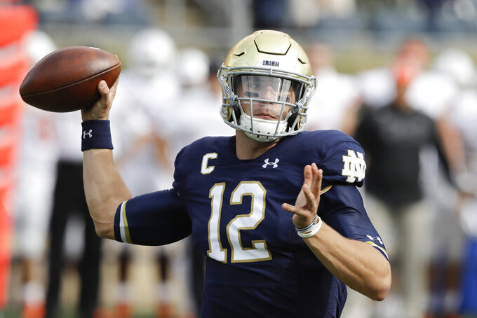 Notre Dame quarterback Ian Book (12) throws during the first half of an NCAA college football game against Bowling Green, Saturday, Oct. 5, 2019, in South Bend, Ind. (AP Photo/Darron Cummings)