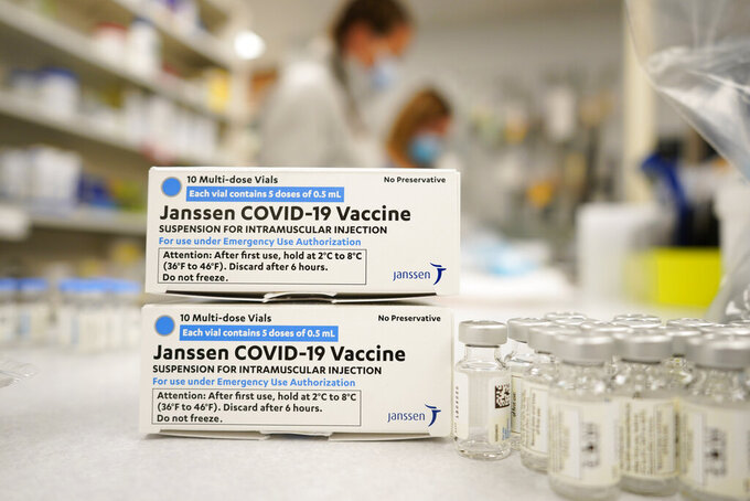 FILE - In this March 6, 2021, file photo, boxes stand next vials of Johnson & Johnson COVID-19 vaccine in the pharmacy of National Jewish Hospital for distribution in Denver. U.S. health officials are weighing next steps as they investigate unusual blood clots in a small number of people given the vaccine -- a one-dose shot that many countries hoped would help speed protection against the pandemic. (AP Photo/David Zalubowski, File)