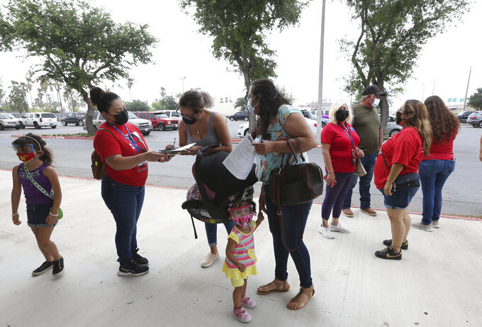 La Union del Pueblo Entero, or LUPE, helped many local farmworkers who were able to receive the Johnson & Johnson dose at the largest COVID-19 vaccine clinic for farmworkers at the Pharr Events Center, Sunday, April 11, 2021, in Pharr, Texas. (Delcia Lopez/The Monitor via AP)