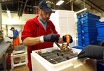 In this Tuesday, Sept. 11, 2018 photo, Jeff Leach packs a live lobster for shipment to Hong Kong at The Lobster Company in Arundel, Maine. The company says it has resorted to layoffs due to shrinking business resulting from tariffs. (AP Photo/Robert F. Bukaty)