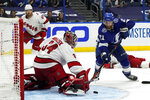 Carolina Hurricanes goaltender Petr Mrazek (34) stops a shot by Tampa Bay Lightning center Brayden Point during overtime in Game 3 of an NHL hockey Stanley Cup second-round playoff series Thursday, June 3, 2021, in Tampa, Fla. (AP Photo/Chris O'Meara)