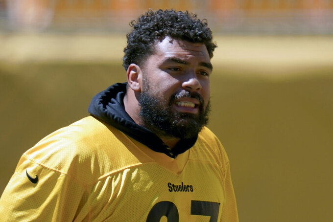 FILE - Pittsburgh Steelers defensive tackle Cameron Heyward is shown during practice at NFL football training camp in Pittsburgh, Wednesday, Aug. 19, 2020. The Steelers signed Heyward to a five-year contract on Monday, Sept. 7, 2020, worth around $75 million. The 31-year-old was entering the final season of a six-year deal he signed in 2015. (AP Photo/Keith Srakocic, File)