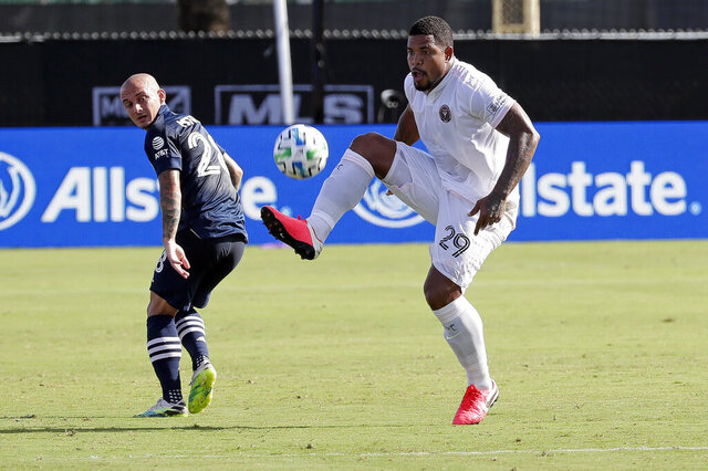 Inter Miami defender Roman Torres (29) gets control of the ball in front of New York City FC midfielder Alexandru Mitrita, left, during the first half of an MLS soccer match, Monday, July 20, 2020, in Kissimmee, Fla. (AP Photo/John Raoux)