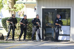 Police officers search for a suspect in a shooting at Ridgway High School in Santa Rosa, Calif., Tuesday, Oct. 22, 2019. (Beth Schlanker/The Press Democrat via AP)
