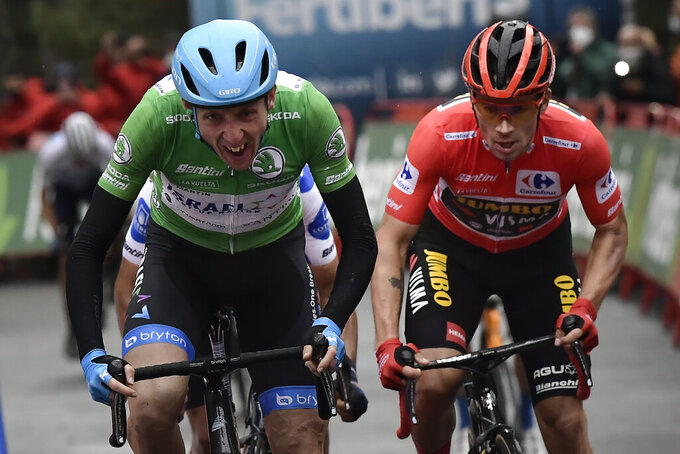 Israel Start-Up's Daniel Martin looks up before crossing the finish line and winning the stage in front Jumbo's Primoz Roglic during the third stage of La Vuelta between Lodosa and La Laguna Negra Vinuesa, in Lodosa, northern Spain, Thursday Oct. 22, 2020. (AP Photo/Alvaro Barrientos)