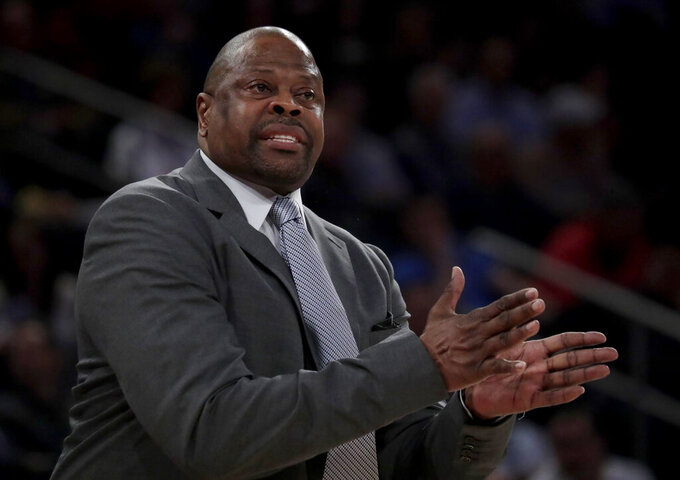 Georgetown head coach Patrick Ewing talks to his team during the first half of an NCAA college basketball game against Seton Hall in the Big East men's tournament, Thursday, March 14, 2019, in New York. Seton Hall won 73-57. (AP Photo/Julio Cortez)