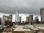 Ominous clouds hang over downtown. Charlotte, North Carolina, on Thursday, Feb. 6, 2020. The city and surrounding areas were under the threat of severe weather during the morning and into the afternoon as a powerful storm rumbled through the Deep South. (AP Photo/Skip Foreman)