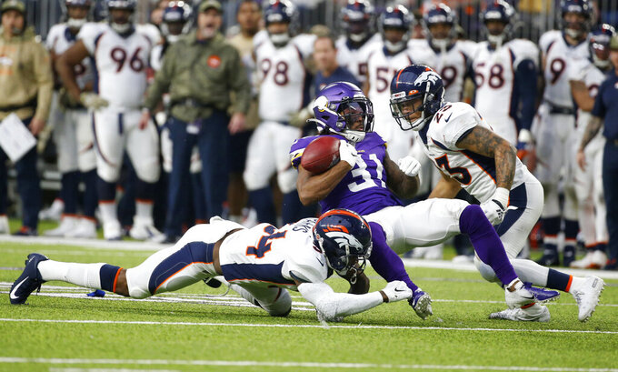 Minnesota Vikings' Ameer Abdullah (31) fumbles the ball as he is tackled by Denver Broncos' Will Parks while returning a kickoff during the first half of an NFL football game, Sunday, Nov. 17, 2019, in Minneapolis. (AP Photo/Bruce Kluckhohn)