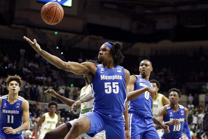 FILE - In this Jan. 12, 2020, file photo, Memphis forward Precious Achiuwa (55) grabs a rebound against South Florida during the second half of an NCAA college basketball game in Tampa, Fla. Achiuwa was selected by the Miami Heat in the NBA draft Wednesday, Nov. 18, 2020. (AP Photo/Chris O'Meara, File)