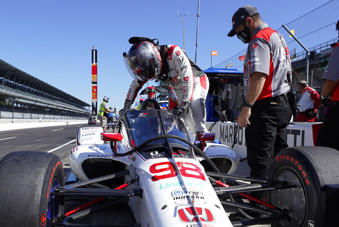 Marco Andretti climbs into his car during the final practice session for the Indianapolis 500 auto race at Indianapolis Motor Speedway, Friday, Aug. 21, 2020, in Indianapolis. (AP Photo/Darron Cummings)