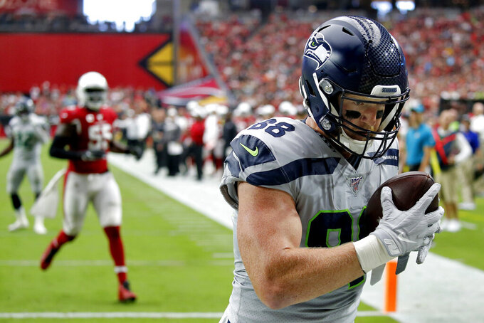Seattle Seahawks tight end Will Dissly (88) pulls in a touchdown pass against the Arizona Cardinals during the first half of an NFL football game, Sunday, Sept. 29, 2019, in Glendale, Ariz. (AP Photo/Ross D. Franklin)
