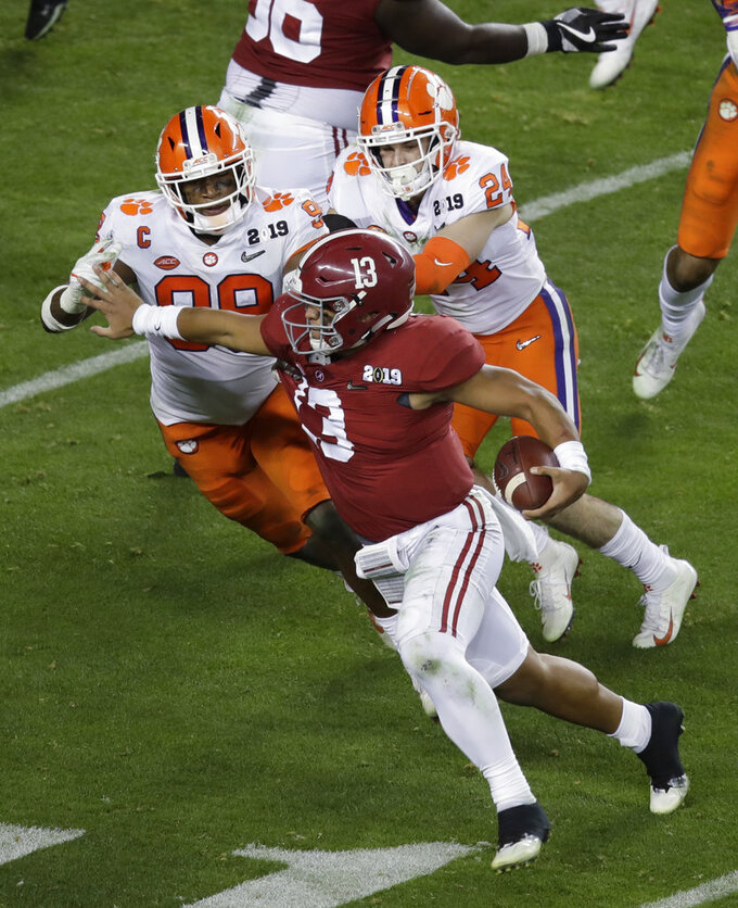 Alabama's Tua Tagovailoa is stopped on a fourth and goal play during the second half of the NCAA college football playoff championship game against Clemson, Monday, Jan. 7, 2019, in Santa Clara, Calif. (AP Photo/Jeff Chiu)