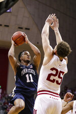 Penn State forward Lamar Stevens (11) shoots over Indiana forward Race Thompson (25) in the second half of an NCAA college basketball game in Bloomington, Ind., Sunday, Feb. 23, 2020. Indiana defeated Penn State 68-60. (AP Photo/Michael Conroy)