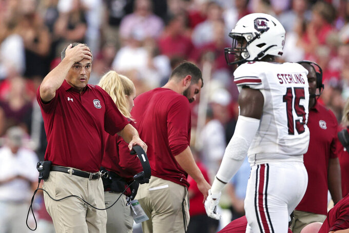 South Carolina coach Shane Beamer reacts after an injury to linebacker Sherrod Greene, not seen, during the first half of the team's NCAA college football game against Georgia on Saturday, Sept. 18, 2021, in Athens, Ga. (AP Photo/Butch Dill)