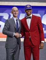 NBA Commissioner Adam Silver poses for photographs with Texas Tech's Jarrett Culver after the Phoenix Suns selected him as the sixth pick overall in the NBA basketball draft Thursday, June 20, 2019, in New York. (AP Photo/Julio Cortez)