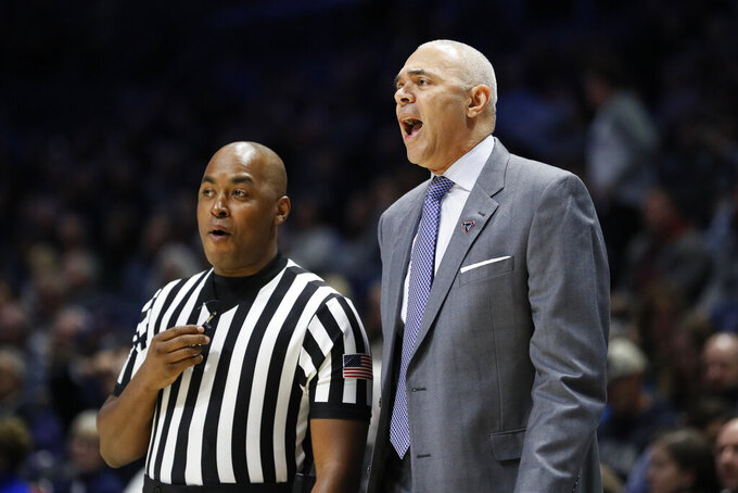DePaul head coach Dave Leitao, right, works the sideline during the first half of an NCAA college basketball game against Xavier, Saturday, Feb. 9, 2019, in Cincinnati. (AP Photo/John Minchillo)