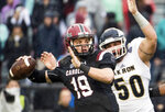 FILE - In this Dec. 1, 2018, file photo, South Carolina quarterback Jake Bentley (19) throws a pass under pressure from Akron defensive lineman Brock Boxen (50) during the first half of an NCAA college football game in Columbia, S.C. Bentley believes South Carolina has made progress this year. He'd like to show that on the field one final time when the Gamecocks take on Virginia at the Belk Bowl next week. (AP Photo/Sean Rayford, File)