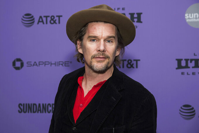 In this Jan. 27, 2020 file photo, Ethan Hawke attends a premiere at the 2020 Sundance Film Festival in Park City, Utah. In a new video filmed from Rome, Hawke is urging people to support the Coolidge Corner Theatre, a Brookline, Mass. independent movie house, which has suffered financially under pandemic-era restrictions and shutdowns. (Photo by Charles Sykes/Invision/AP, file)