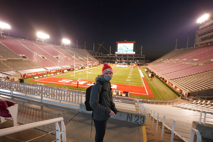 A Utah student looks on before an NCAA college football game against Oregon State, Saturday, Dec. 5, 2020, in Salt Lake City. (AP Photo/Rick Bowmer)