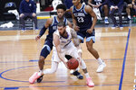 Seton Hall forward Sandro Mamukelashvili, foreground, drives against Villanova guard Justin Moore during the first half of an NCAA college basketball game, Saturday, Jan. 30, 2021, in Newark, N.J. (AP Photo/Mary Altaffer)
