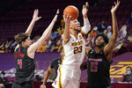 Minnesota's Brandon Johnson (23) shoots between Rutgers' Paul Mulcahy (4) and Myles Johnson (15) in the first half of an NCAA college basketball game, Saturday, March 6, 2021, in Minneapolis. (AP Photo/Jim Mone)