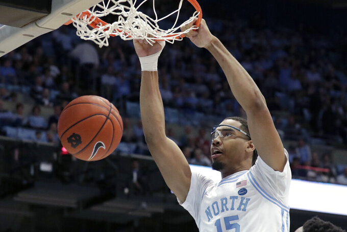 FILE - In this March 3, 2020, file photo, North Carolina's Garrison Brooks dunks against Wake Forest during the first half of an NCAA college basketball game in Chapel Hill, N.C. Brooks is a 6-foot-10 senior and was the preseason Atlantic Coast Conference player of the year. (AP Photo/Chris Seward, File)