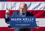 FILE - In this Feb. 23, 2019, file photo, Mark Kelly speaks during his senate campaign kickoff event in Tucson, Ariz. Arizona will be in the national spotlight in November as a presidential battleground and the home of one of the most closely watched Senate contests in the country. But Tuesday's primary on Aug. 4, 2020, features few big-ticket contests. Kelly, a retired astronaut and the husband of former U.S. Rep. Gabrielle Giffords, faces only a write-in opponent for the Democratic nomination. (Mike Christy/Arizona Daily Star via AP, File)