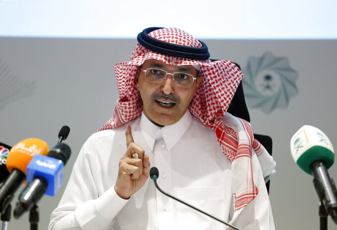 FILE - In this Dec. 9, 2019 file photo, Saudi Finance Minister Mohammed al-Jadaan speaks during a news conference to announce Saudi Arabia's annual budget at the finance ministry, in Riyadh, Saudi Arabia.  The Group of 20 nations, representing the world's biggest economies, announced Friday, Nov. 13, 2020, that low-income countries hardest hit by the fallout of the coronavirus pandemic could potentially get an extension on their debt payments beyond mid-2021, and in the most severe cases, a debt write-off. (AP Photo/Amr Nabil)