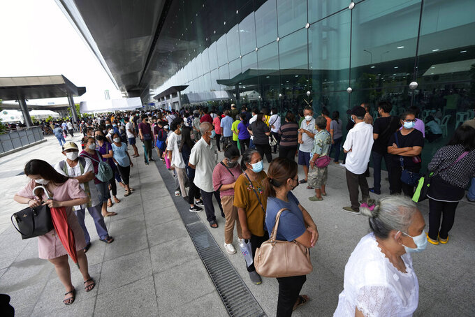 Residents wait on line to receive shots of the AstraZeneca COVID-19 vaccine at the Central Vaccination Center in Bangkok, Thailand, Thursday, July 22, 2021. (AP Photo/Sakchai Lalit) wait on line