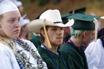 Quentin Smith wears his cowboy hat with tassel at the graduation ceremonies at Paradise High School in Paradise, Calif., Thursday June 6, 2019. Most of the students of Paradise High lost their homes when the Camp Fire swept through the area and the school was forced to hold classes in Chico. The seniors gathered one more time at Paradise High for graduation ceremonies. (AP Photo/Rich Pedroncelli)