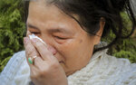 REMOVES REFERENCE TO HOMELESS KILLED  - Choi Fung Lin wipes away tears following the funeral for Chuen Kok at the Ng Fook Funeral Home Friday Oct. 18, 2019, in New York. Lin, a Chinatown resident, knew Kok for 18 years and often checked on him after he started to