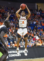 Oklahoma State guard Avery Anderson III shoots against Minnesota during an NCAA college basketball game Saturday, Dec. 21, 2019, in Tulsa, Okla. (Brett Rojo/Tulsa World via AP)