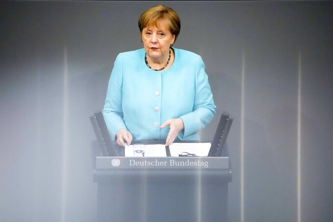 German Chancellor Angela Merkel delivers her specs ahed of a EU summit at the German parliament Bundestag in Berlin, Germany, Thursday, June 24, 2021. (AP Photo/Markus Schreiber)
