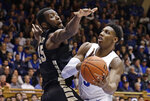 Duke's RJ Barrett (5) drives to the basket against Wake Forest's Ikenna Smart (35) during the second half of an NCAA college basketball game in Durham, N.C., Tuesday, March 5, 2019. Duke won 71-70. (AP Photo/Gerry Broome)