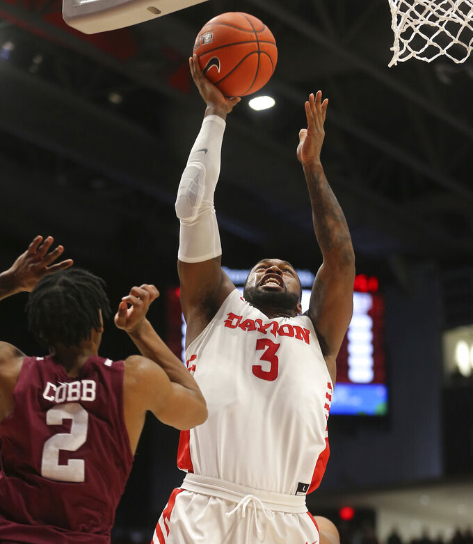 Dayton's Trey Landers (3) drives to the basket against Fordham's Jalen Cobb (2) during the first half of an NCAA college basketball game Saturday, Feb. 1, 2020, in Dayton, Ohio. (AP Photo/Tony Tribble)