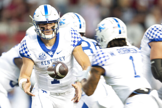 Kentucky quarterback Will Levis (7) pitches the ball to Kentucky wide receiver Wan'Dale Robinson (1) in the first half of an NCAA college football game against South Carolina, Saturday, Sept. 25, 2021, at Williams-Brice Stadium in Columbia, S.C. (AP Photo/Hakim Wright Sr.)