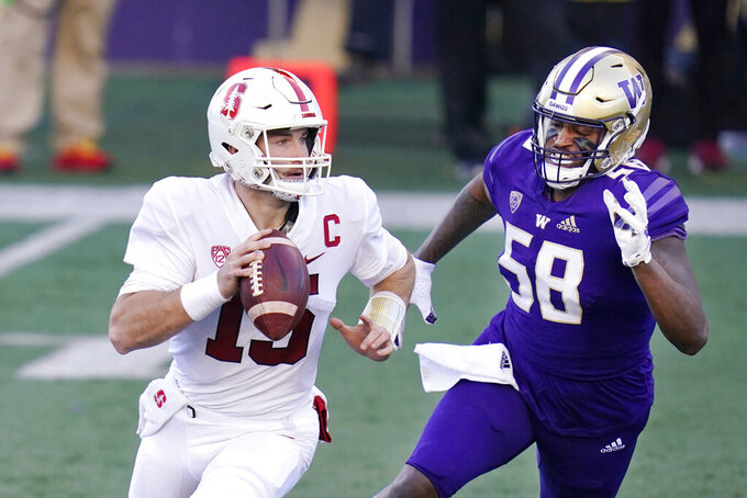Washington linebacker Zion Tupuola-Fetui (58) pressures Stanford quarterback Davis Mills in the first half of an NCAA college football game Saturday, Dec. 5, 2020, in Seattle. (AP Photo/Elaine Thompson)