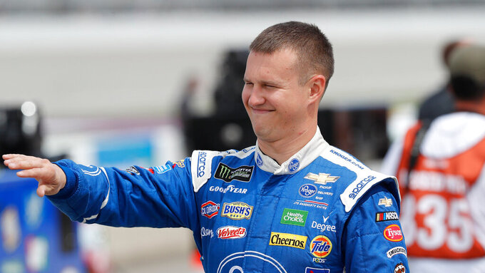 Ryan Preece walks to his car before qualifying for the NASCAR cup series race at Michigan International Speedway, Saturday, June 8, 2019, in Brooklyn, Mich. (AP Photo/Carlos Osorio)